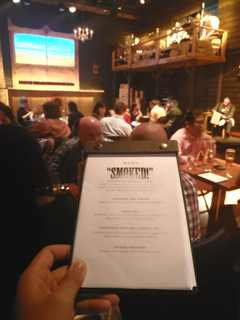 "Dinner theatre watching the play ""Smoked!"" Mysterious lone ranger makes his mark on a wild wild west town."